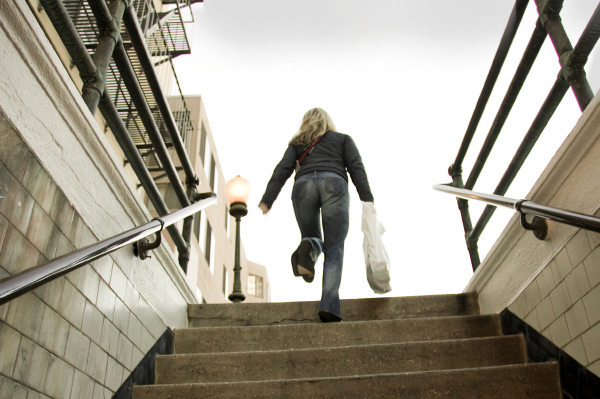 Woman climbing stairs in winter