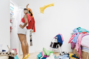 Woman cleaning closet