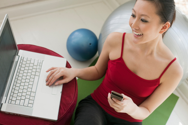 Woman downloading exercise video