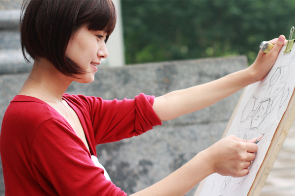 Woman drawing outdoors