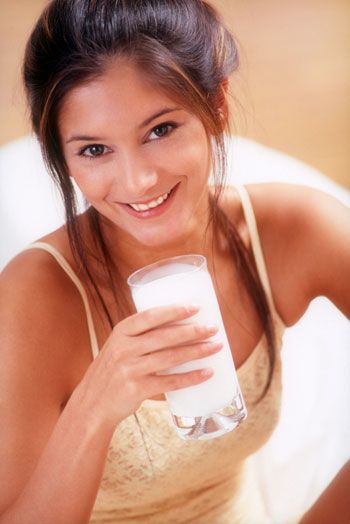 Woman drinking milk in pajamas