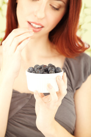 http://cdn.sheknows.com/articles/woman-eating-blueberries.jpg