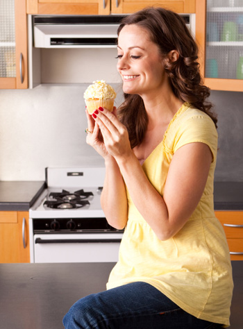 Woman Eating Muffin