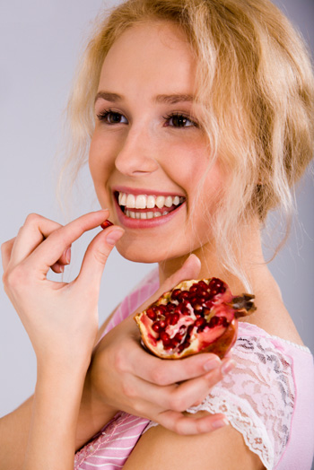Woman Eating Pomegranate