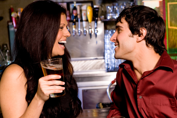 Woman flirting with guy in bar