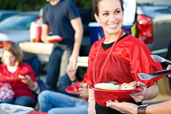 Woman in Football Jersey with Food