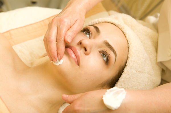 Woman getting facial at spa