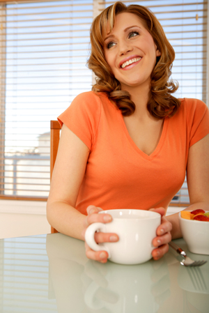 Woman having coffee at breakfast