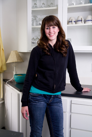 Woman in white kitchen