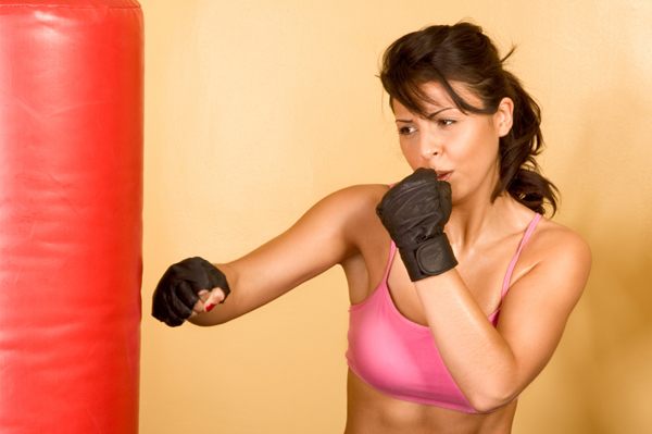 Woman in pink kickboxing