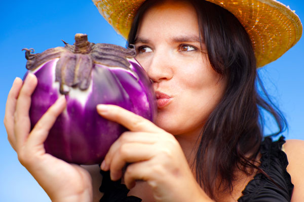 Woman kissing eggplant