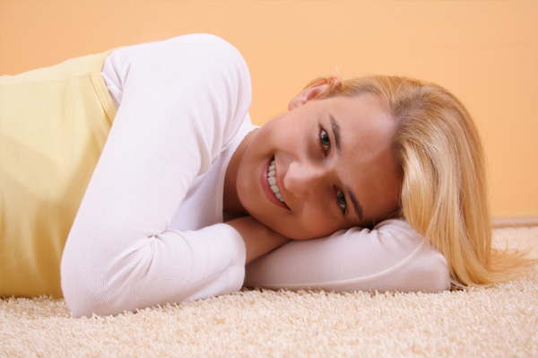 Woman lying down on carpet