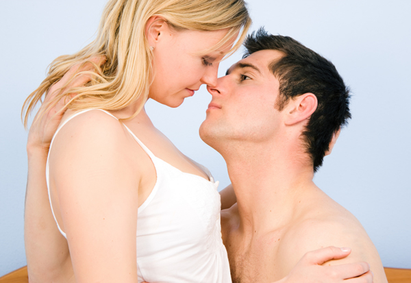 http://cdn.sheknows.com/articles/woman-man-kissing-in-bed.jpg