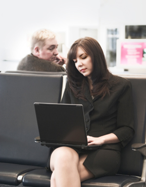 Woman on Computer in Public Setting