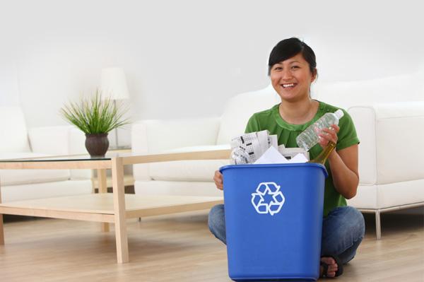 Woman Organizing Recycling
