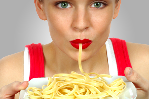 Woman Overeating Pasta