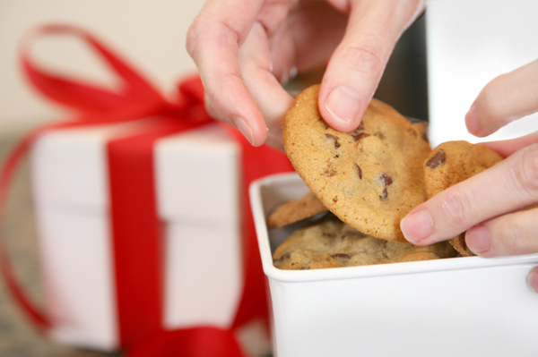Woman Packaging Cookies for Christmas