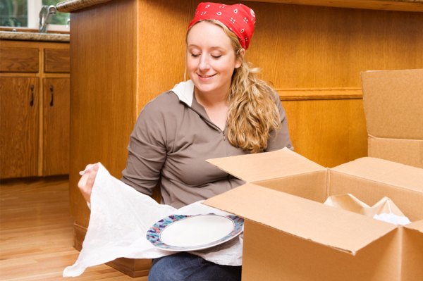 Woman Packing Dishes