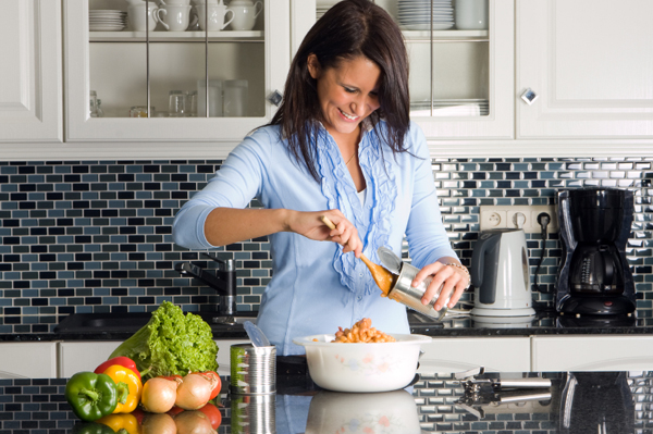 Woman preparing dinner from can