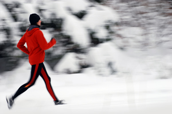 Woman Running in Snow