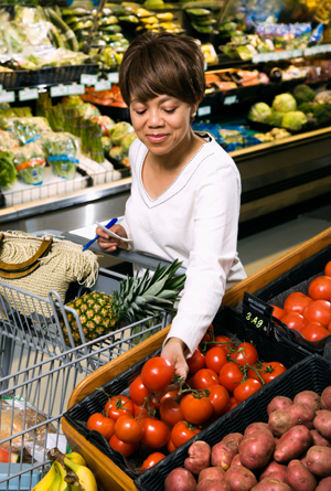 Woman selecting tomato