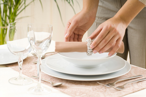 Woman setting dinner table