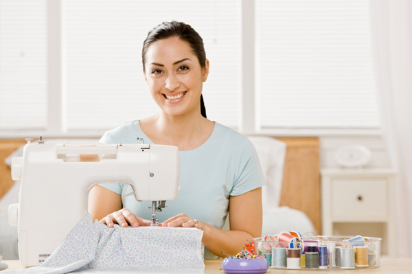 Woman sewing at home