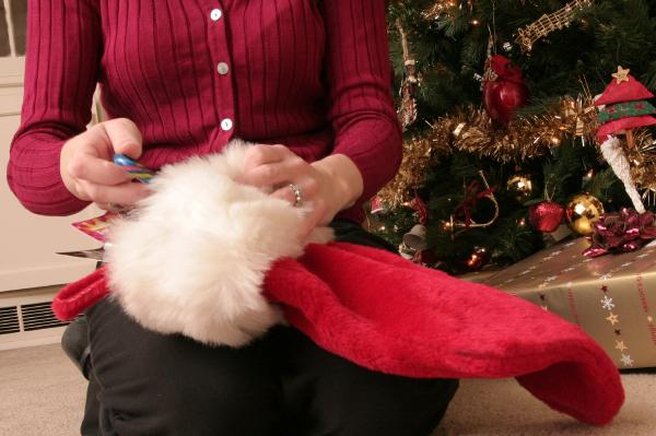 Woman stuffing stocking
