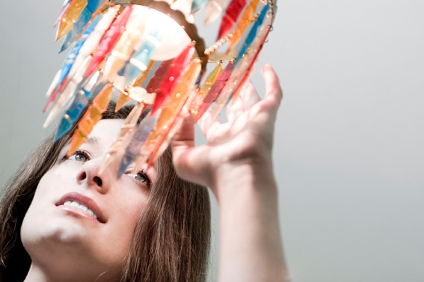 Woman touching colorful chandelier