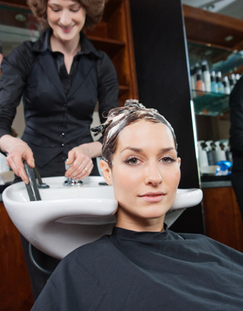 Woman wearing hair mask at salon