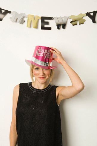 woman wearing new years hat