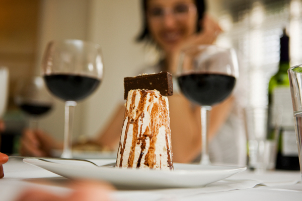 Woman with dessert and wine