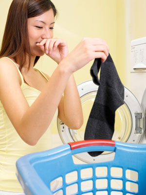 Woman with smelly laundry