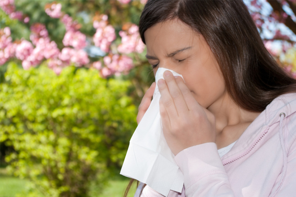 Woman with spring allergies or common cold