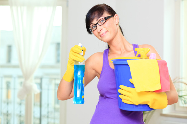 Woman with cleaning supplies