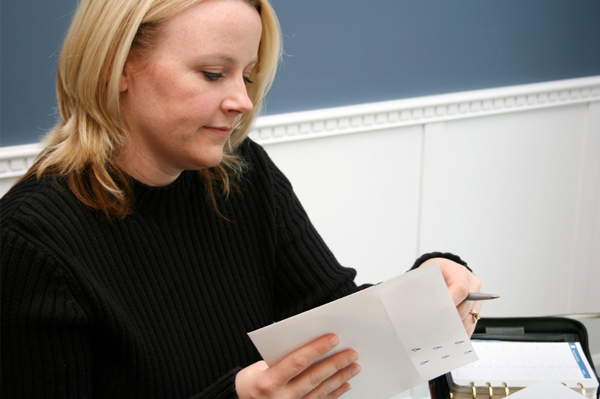 Woman writing invitations