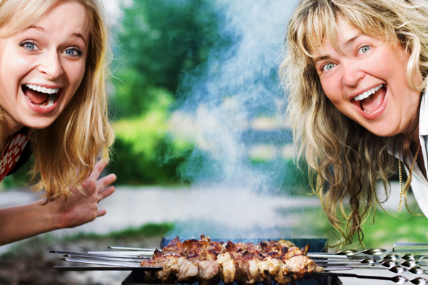 Woman and BBQ Grill