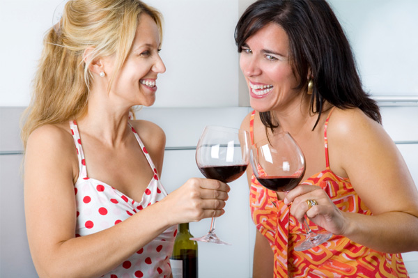 Women at party drinking wine