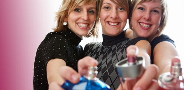 3 women spraying perfume