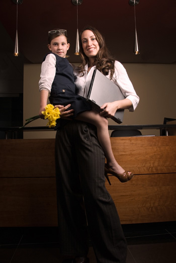 Working mother holding daughter