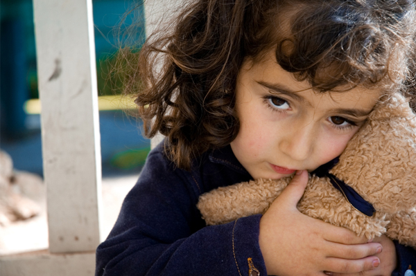 Worried Girl with Teddy Bear