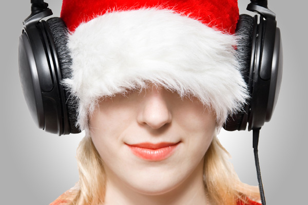 Woman with Santa Hat and Headphones