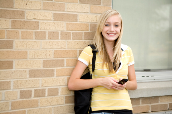 Young teen girl texting