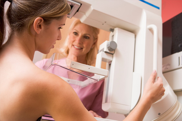 Woman getting mammogram