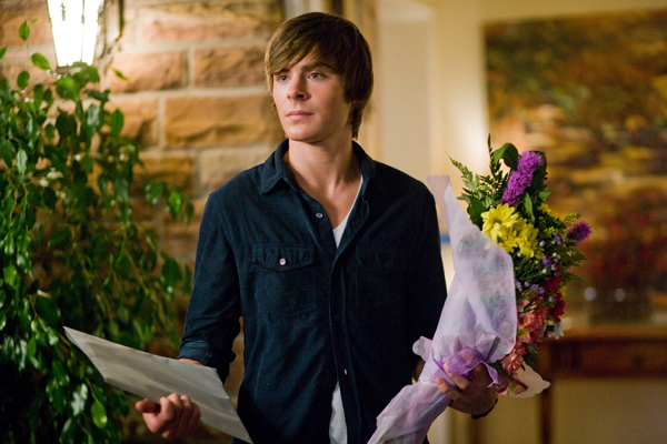 Who could resist Zac Efron with flowers?