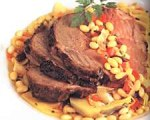 Herb Roasted Leg of Lamb with White Bean Fennel and Olive Ragout