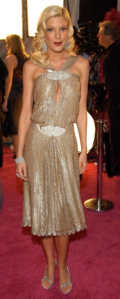 Tori glitters in gold