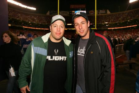 Adam Sandler and Kevin James pose at a football game