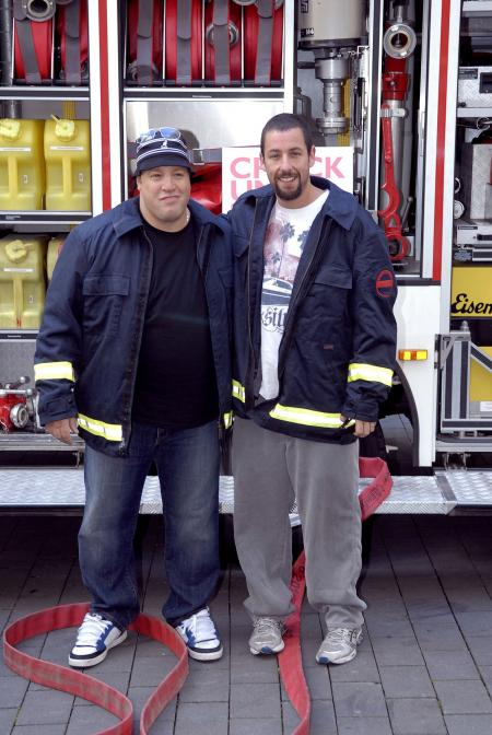 Kevin James and Adam Sandler pose on the movie set