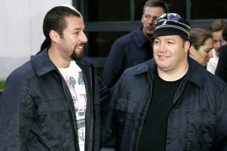Adam Sandler and Kevin James pose on the set